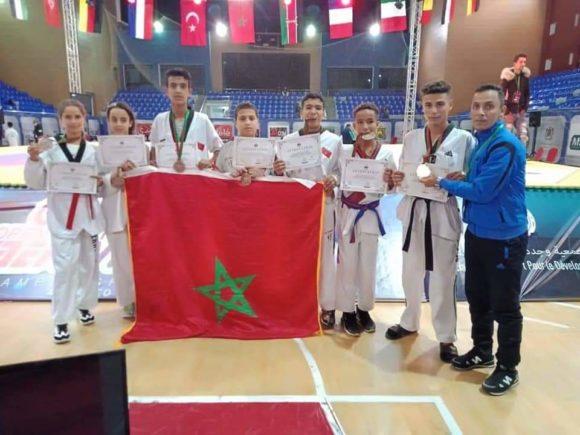 7 ميداليات لرحاب الابطال للتكواندو من القصر الكبير في تظاهرة كبرى بوجدة
